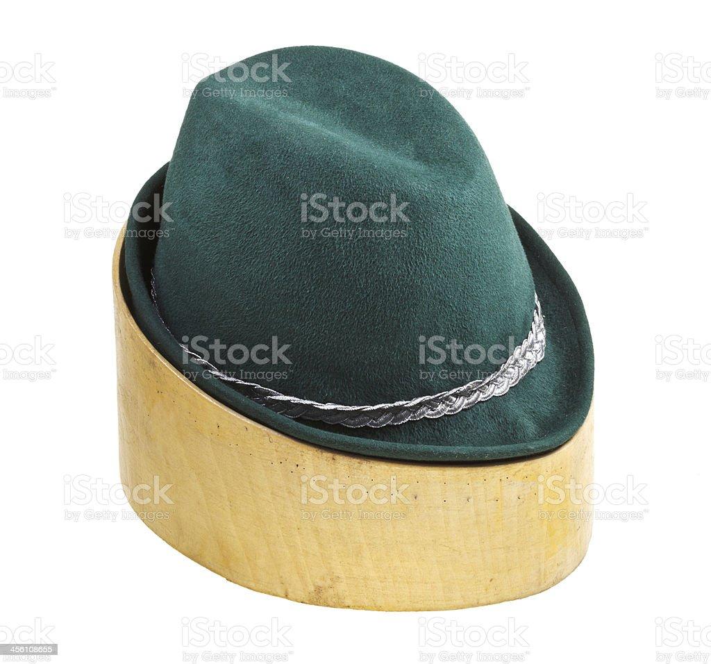 green tyrolean felt hat on linden wooden block royalty-free stock photo