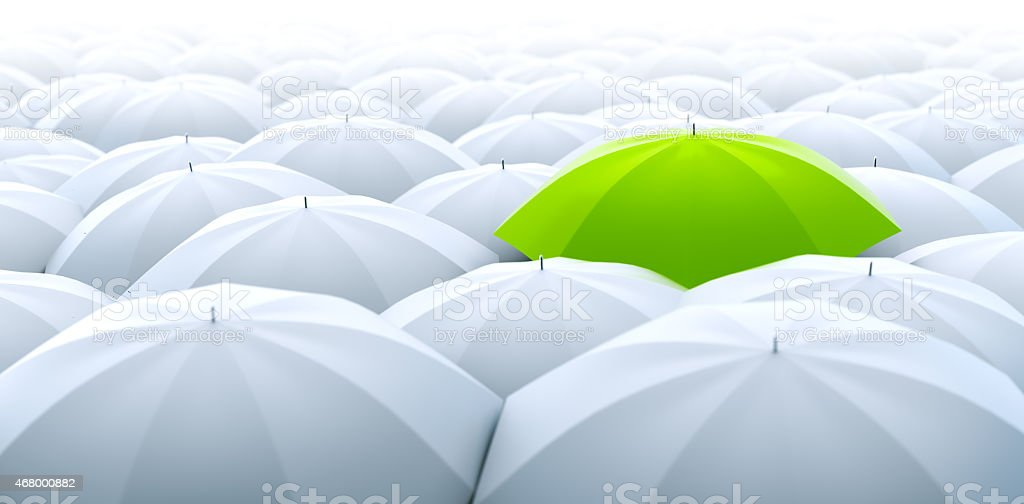 Green umbrella. Different, leader, unique, boss, individuality, original, special concept stock photo