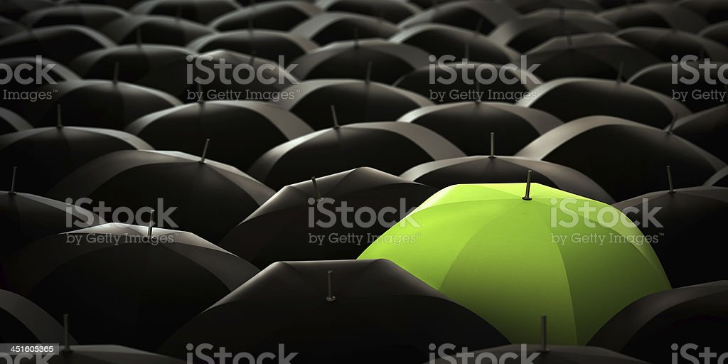Green umbrella in blacks stock photo