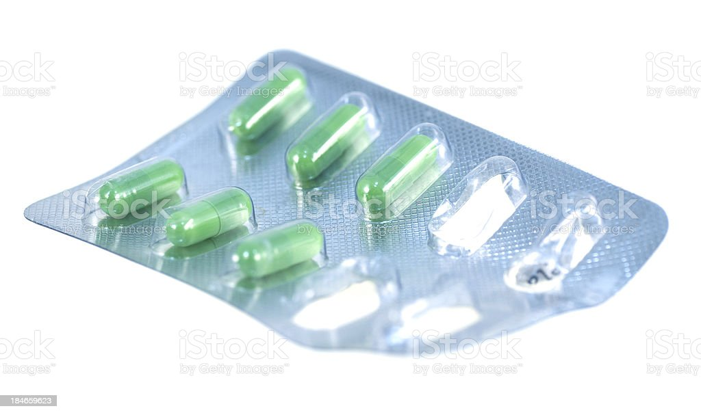 green used pills on white background royalty-free stock photo