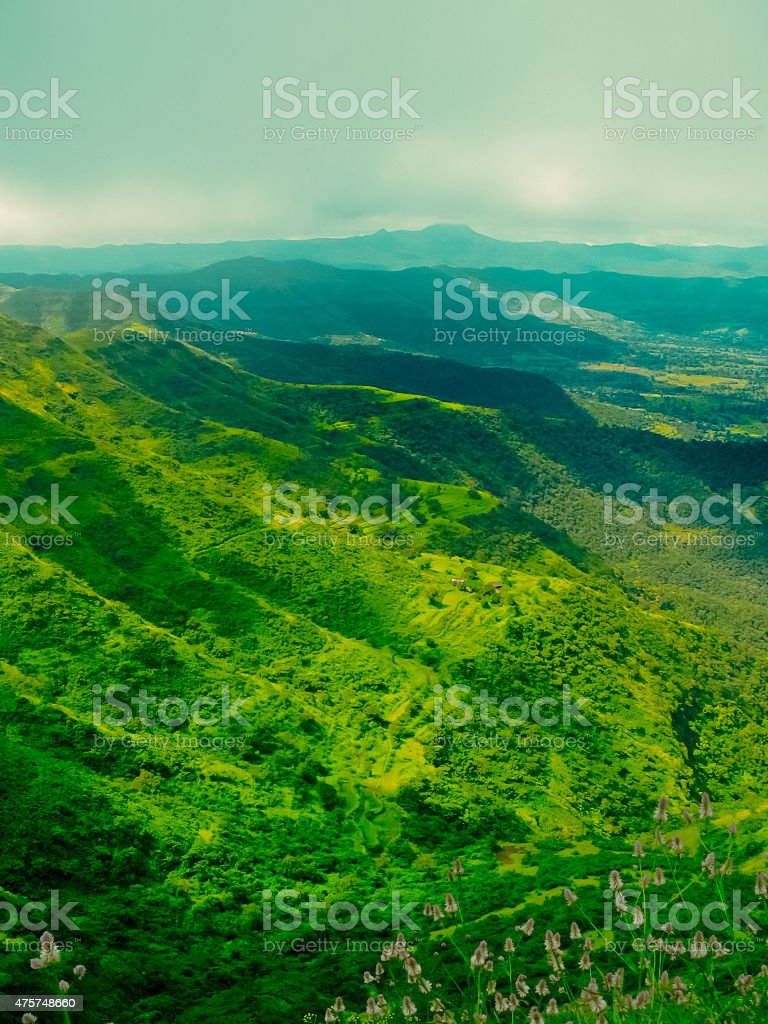 Green valley and hill range stock photo