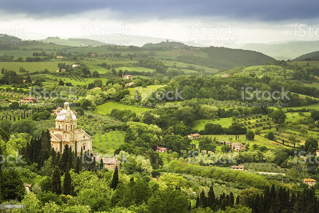 Green valley and red roofs in Volterra, Italy royalty-free stock photo