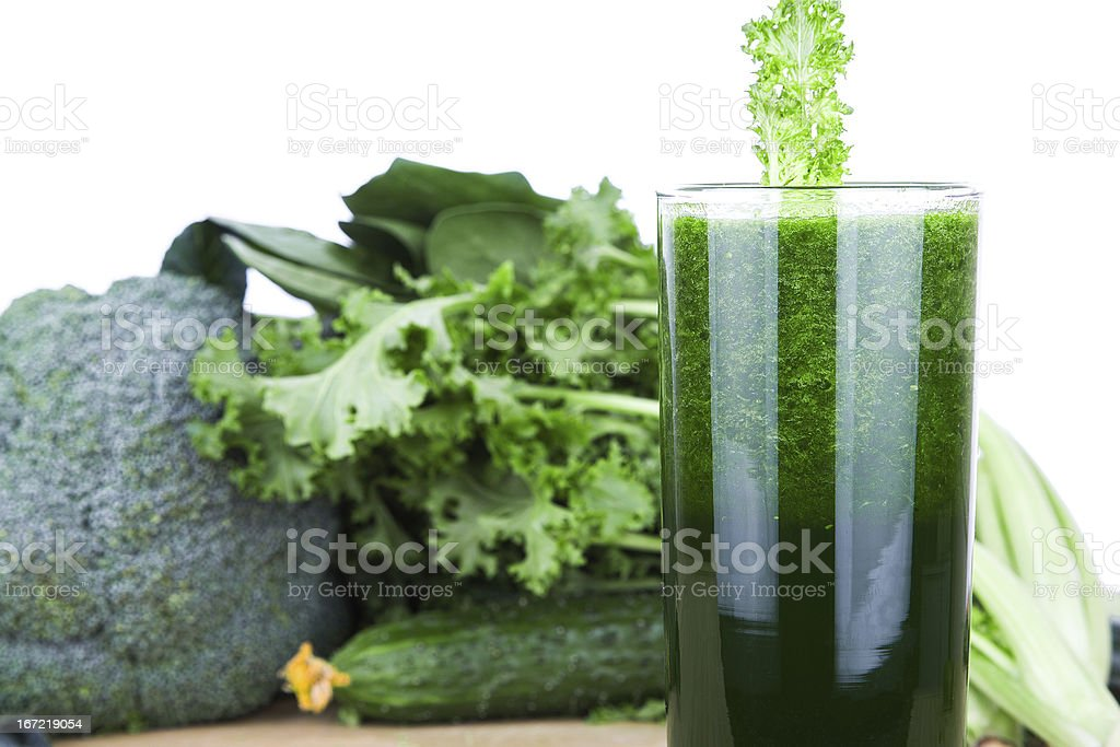 Green vegetable juice isolated on white background royalty-free stock photo