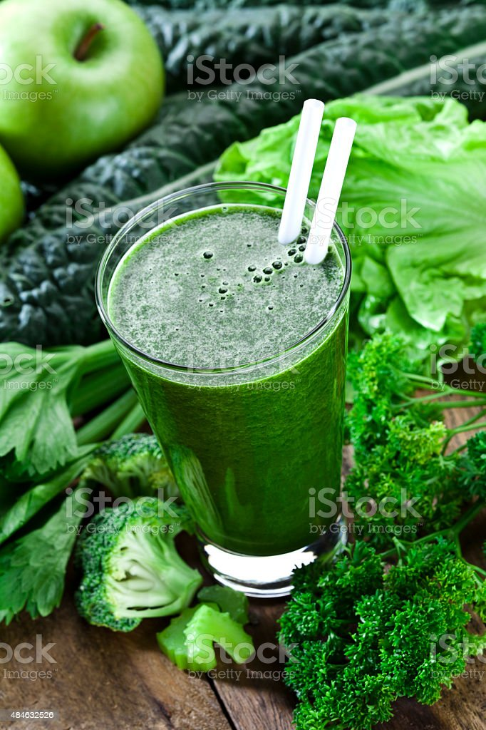Green vegetable juice on rustic wood table stock photo
