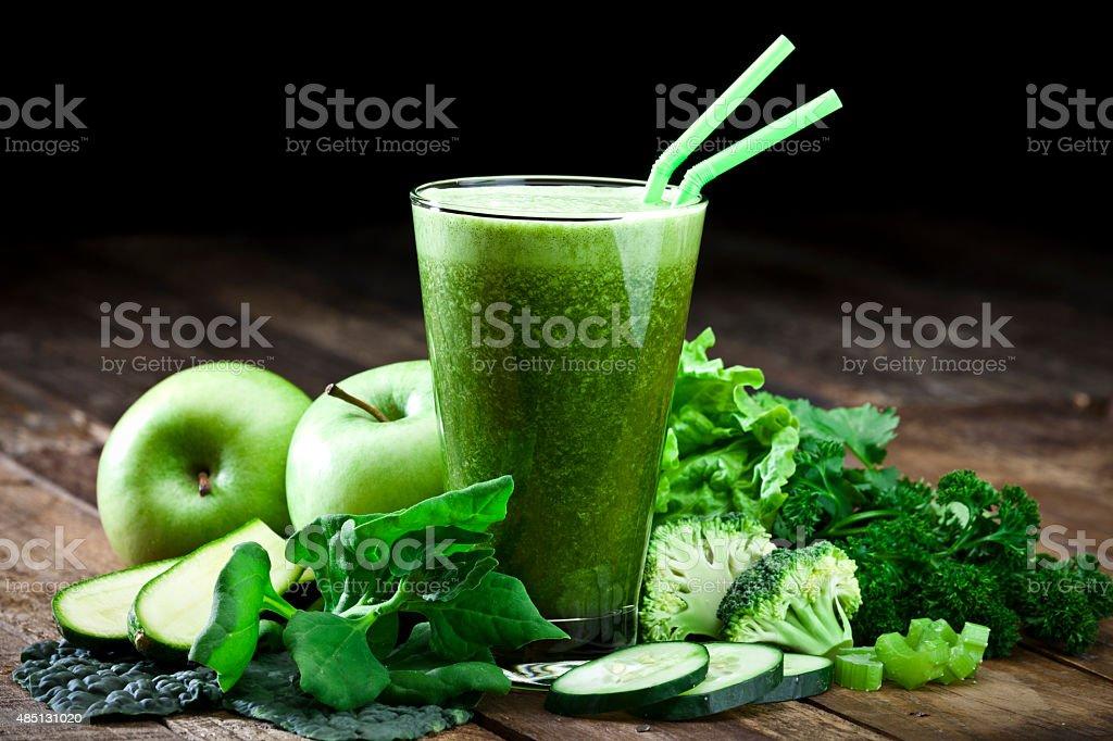 Green vegetable juice on rustic wood table stock photo