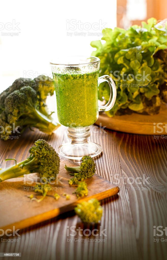 Green vegetable smoothie drink with brocolli stock photo