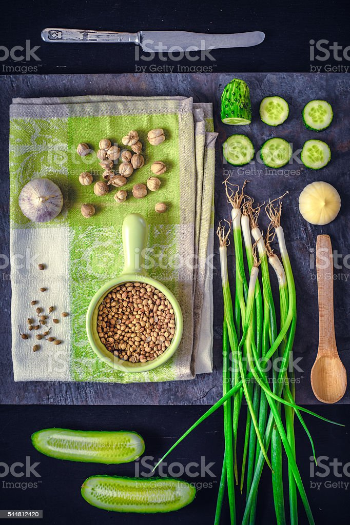 Green vegetables with seasoning on the dark stone background vertical stock photo
