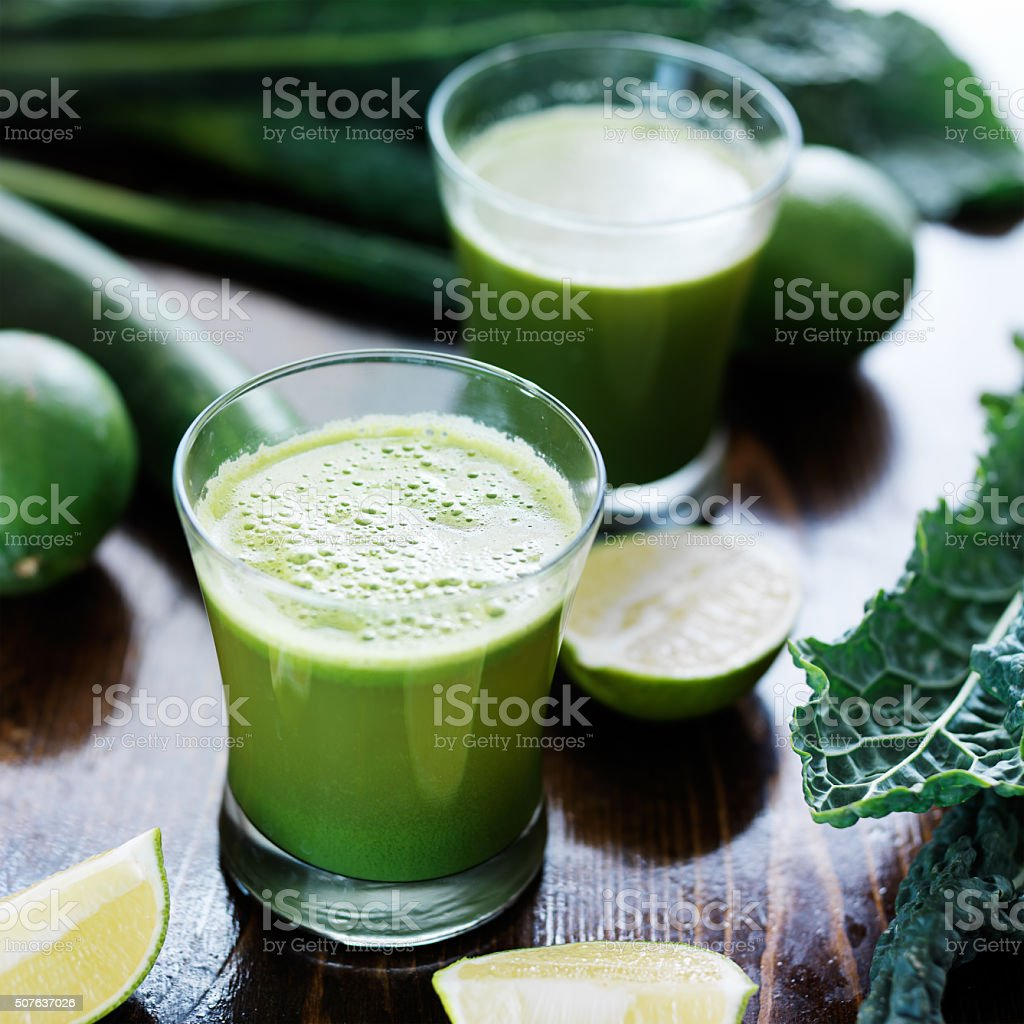 green veggie smoothie stock photo