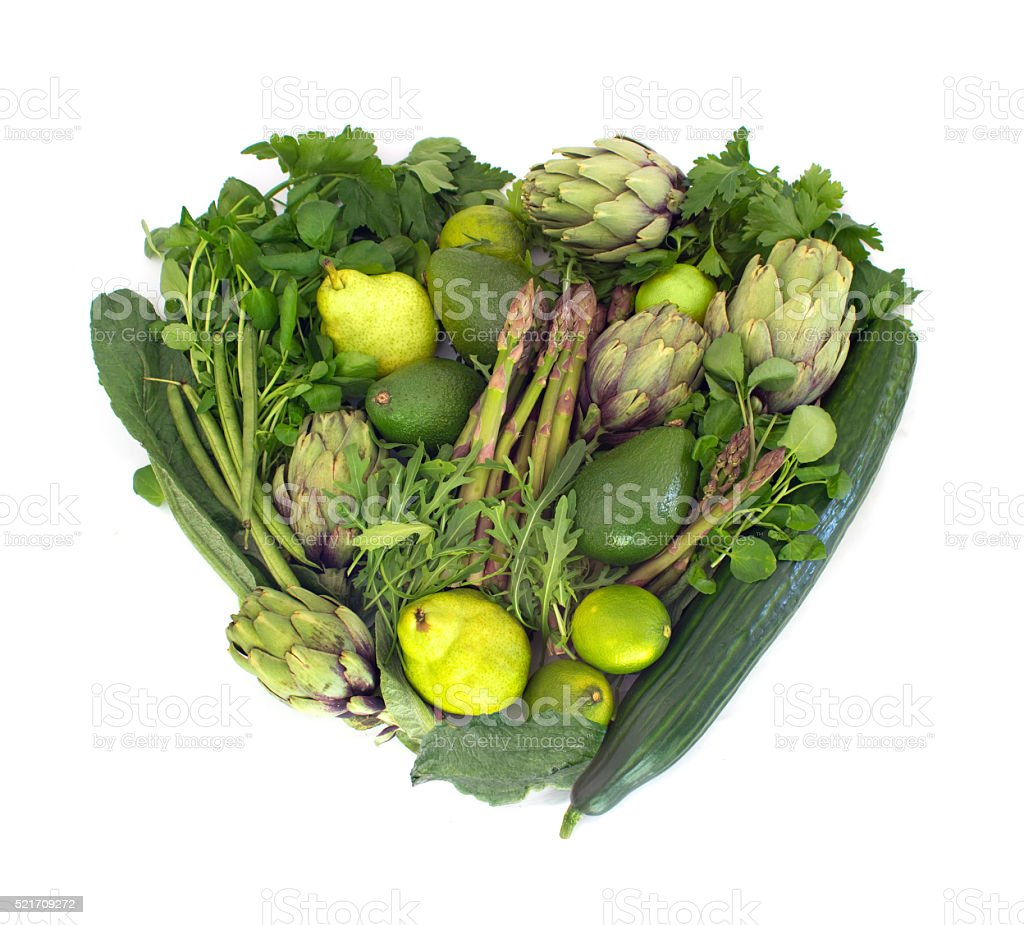 Green veggies heart on white stock photo