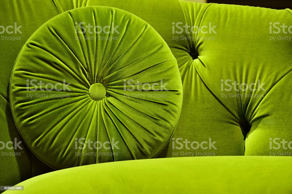 Green velvet couch with cushion stock photo