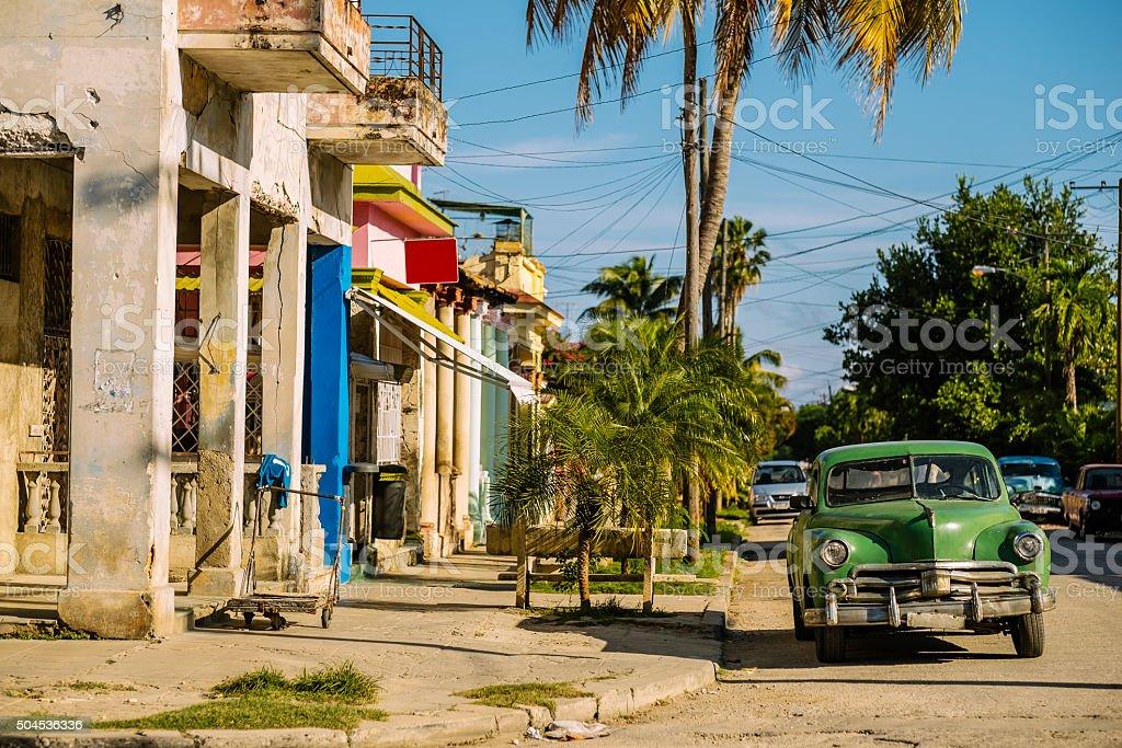 Green Vintage car at Miramar corner stock photo