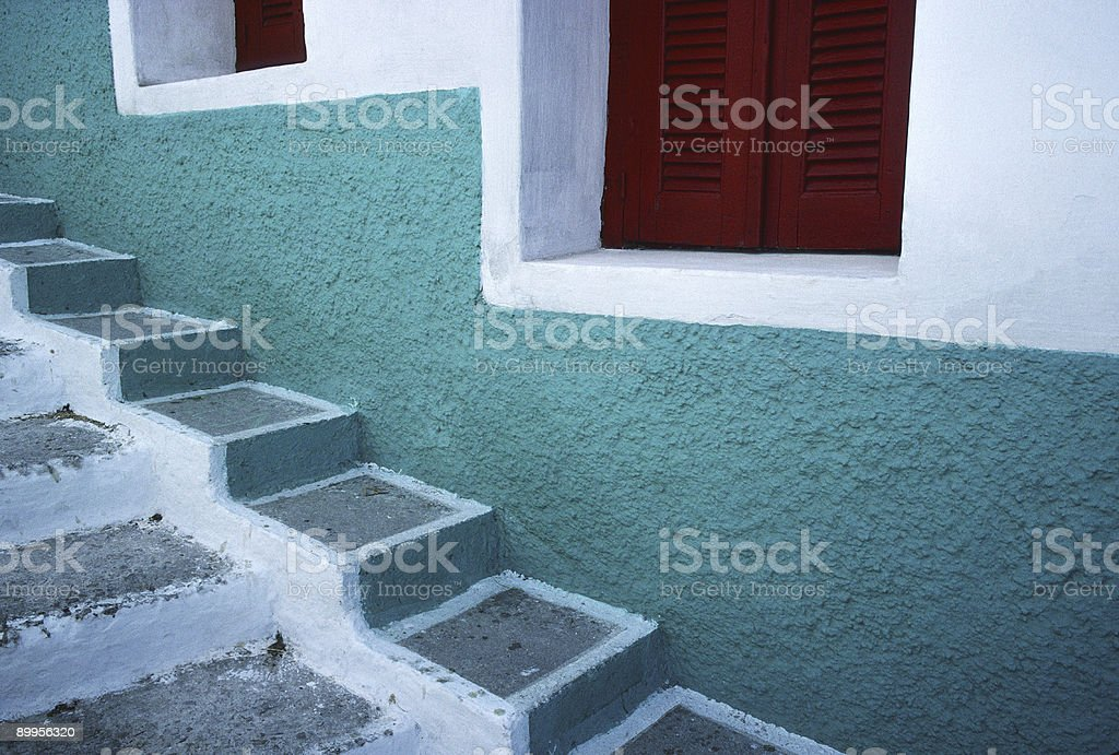 Green Wall, Red Windows and Stairs, Naxos, Greece stock photo