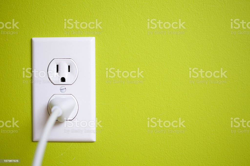 A green wall with a power socket stock photo