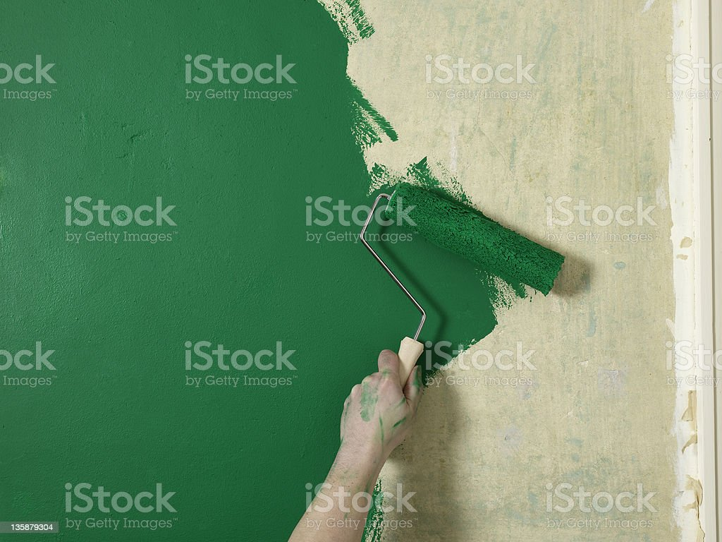 green wall with roller stock photo