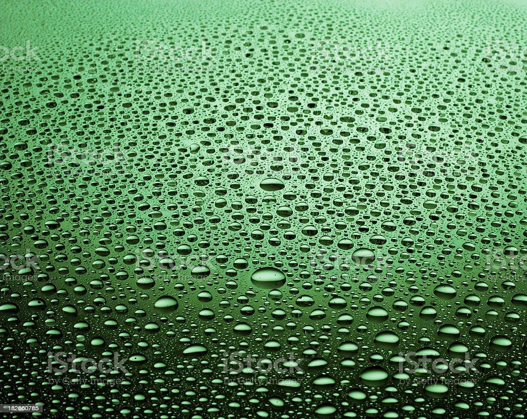 Green waterdrops stock photo