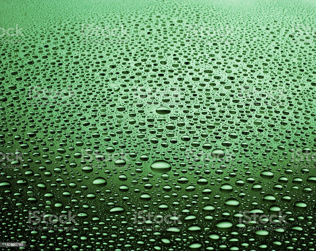Green waterdrops stock photo