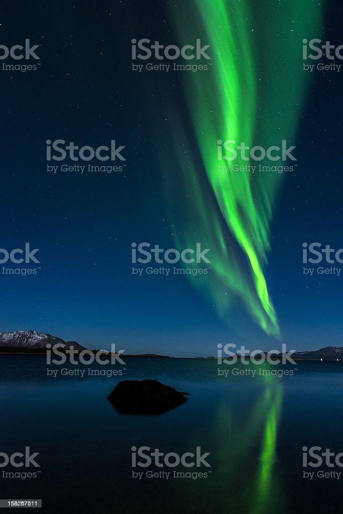 Green wavy streaks of the Aurora Borealis in the night sky royalty-free stock photo