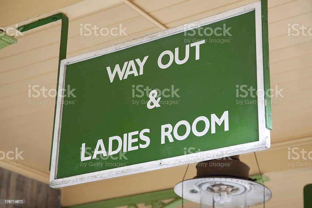 Green Way Out and Ladies Toilet Sign royalty-free stock photo