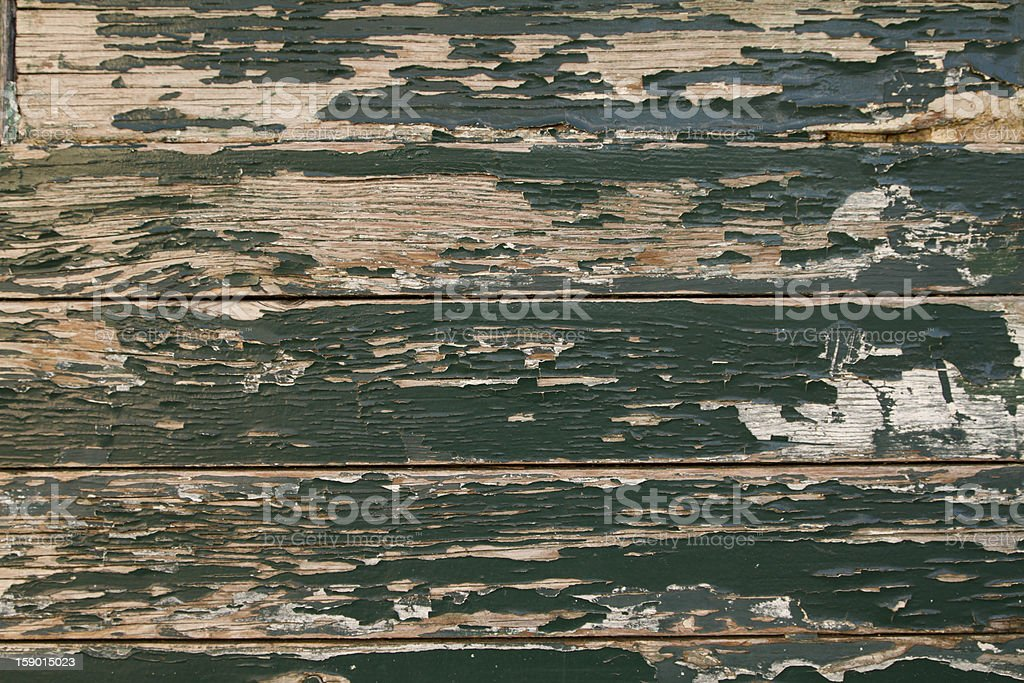 Green weathered wooden door texture, Italy royalty-free stock photo