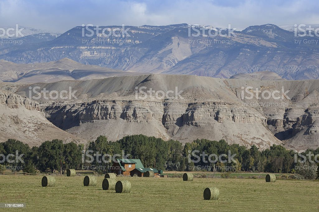 Green Western Ranch Below Stunning Mountains royalty-free stock photo