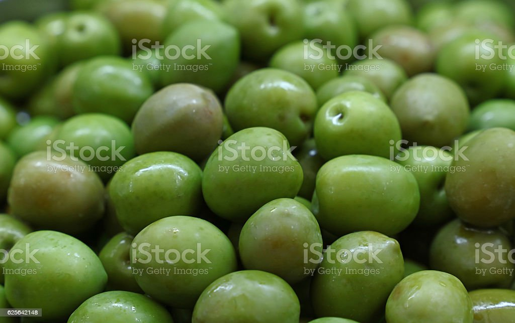Green whole olives close up background stock photo