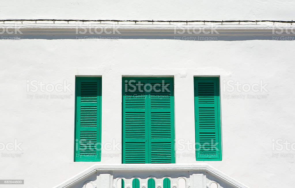 Green window shutters, Tangier, Morocco stock photo