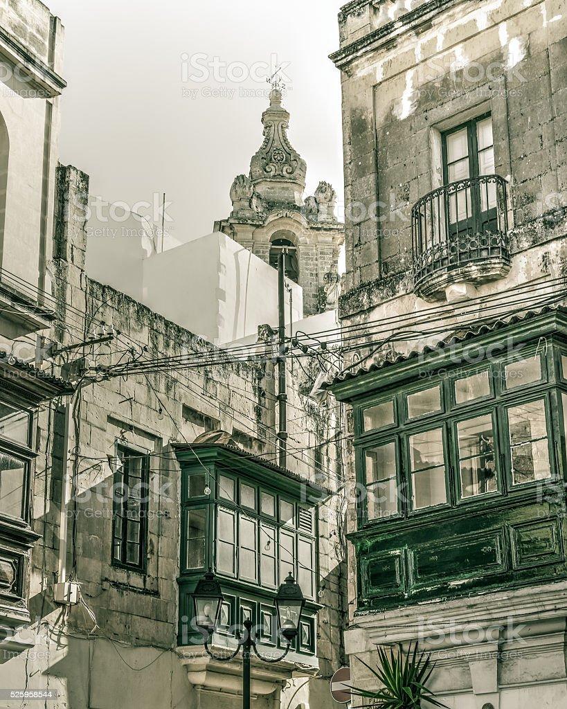 Green windows and balcony, Malta stock photo