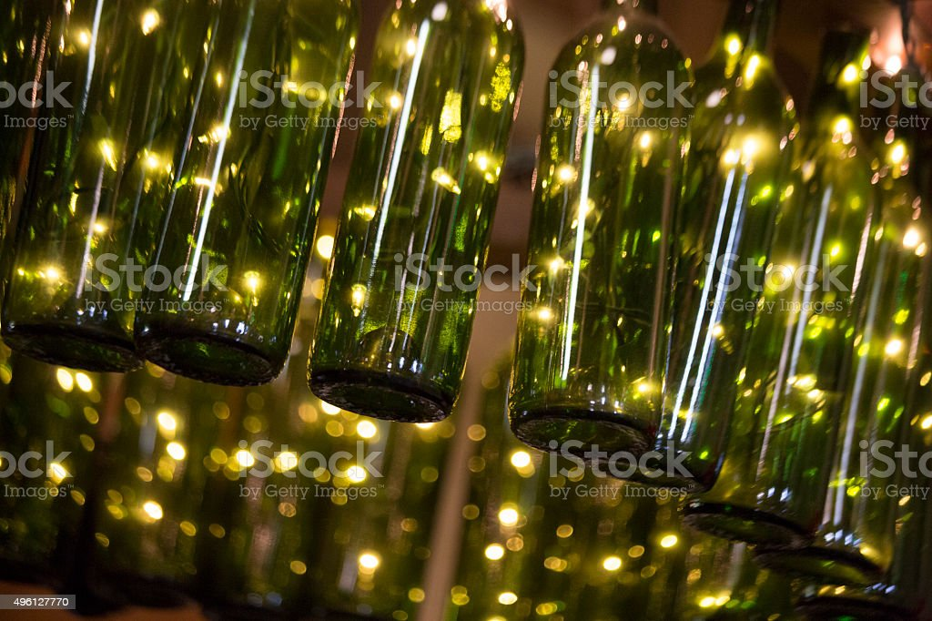 Green Wine Bottles as Light Fixture, Abstract Background stock photo