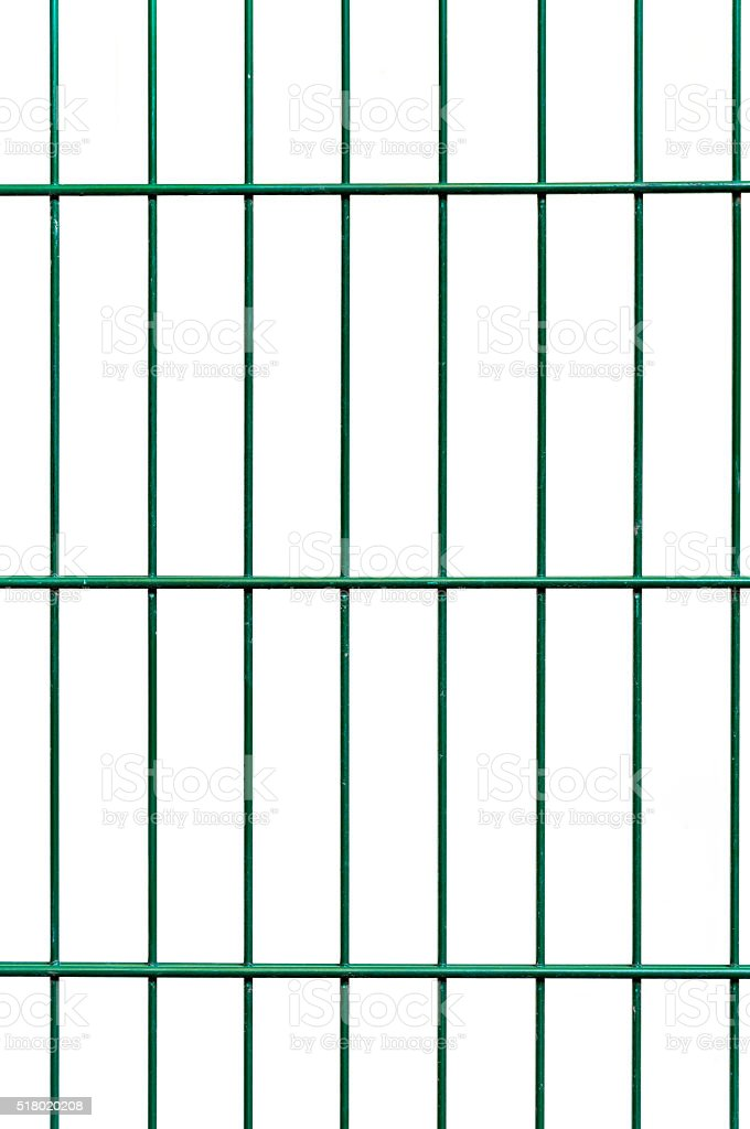 Green wire netting fence before white wall background stock photo
