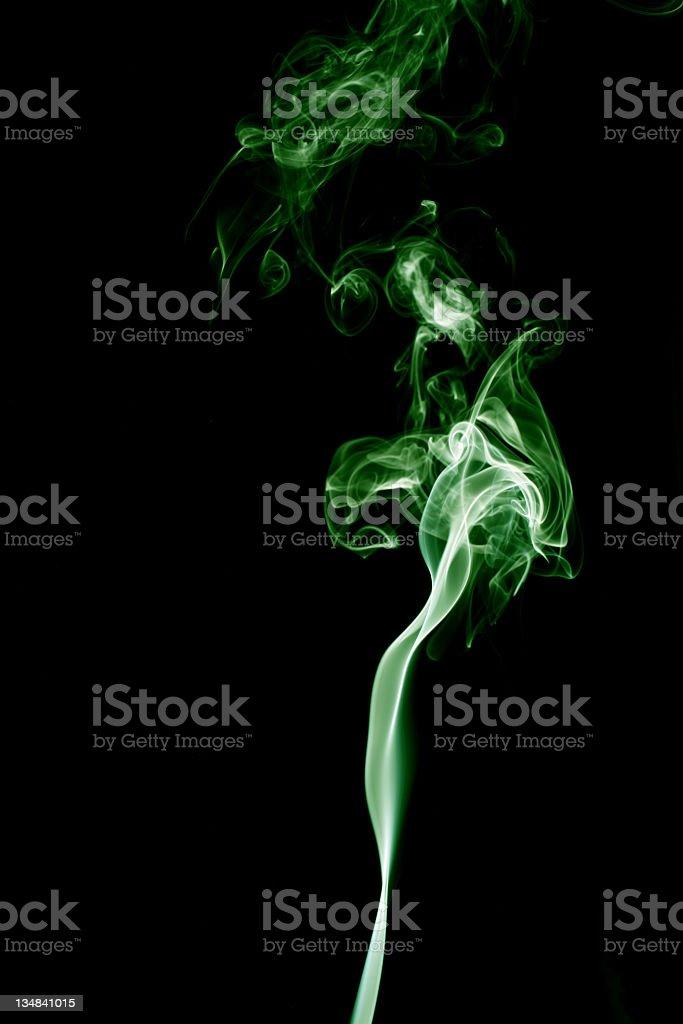 Green wispy smoke. Black background. royalty-free stock photo