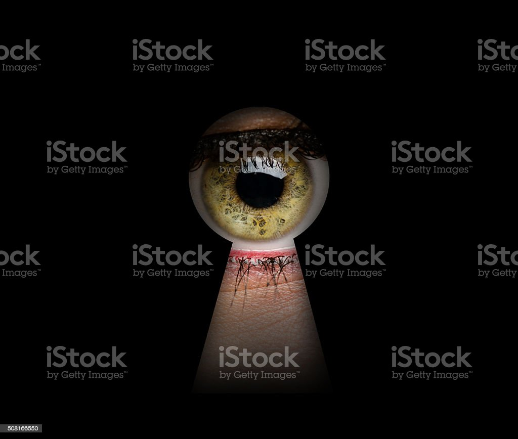 Green Woman Eye and Keyhole stock photo