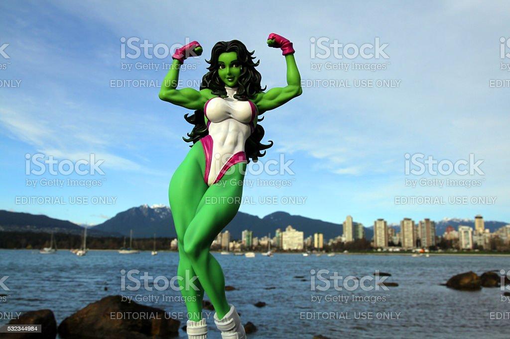 Green Woman on the Coast stock photo
