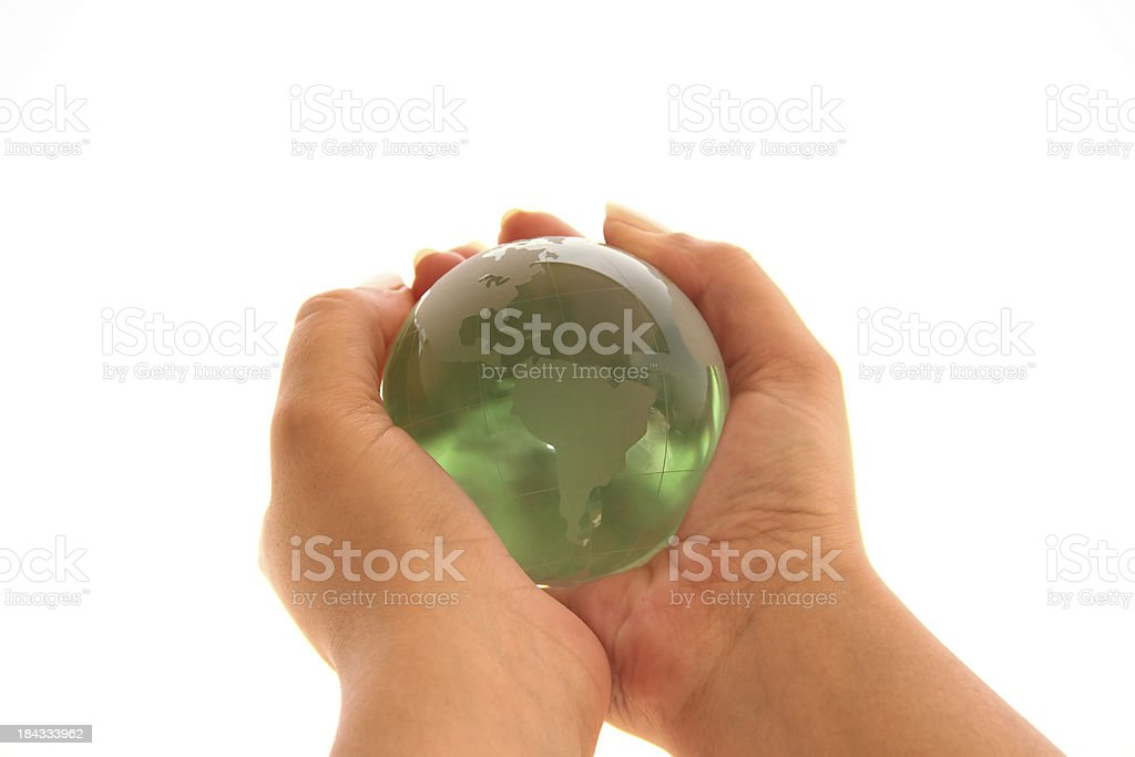 Green world in hands royalty-free stock photo