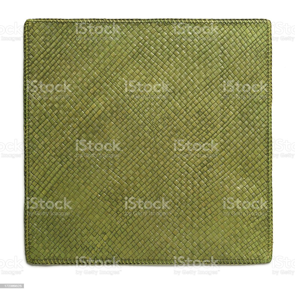 Green woven placemat on white background stock photo