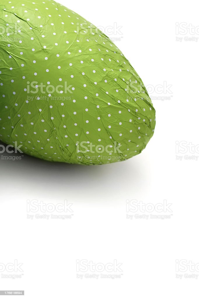 Green wrapped Easter Egg from corner royalty-free stock photo