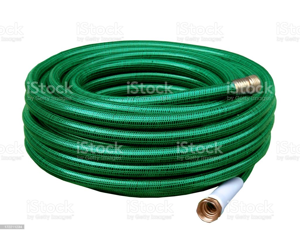 Green yard hose coiled up for storage royalty-free stock photo