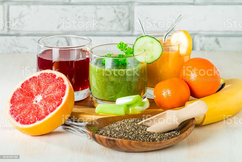 Green, yellow and red beverages stock photo