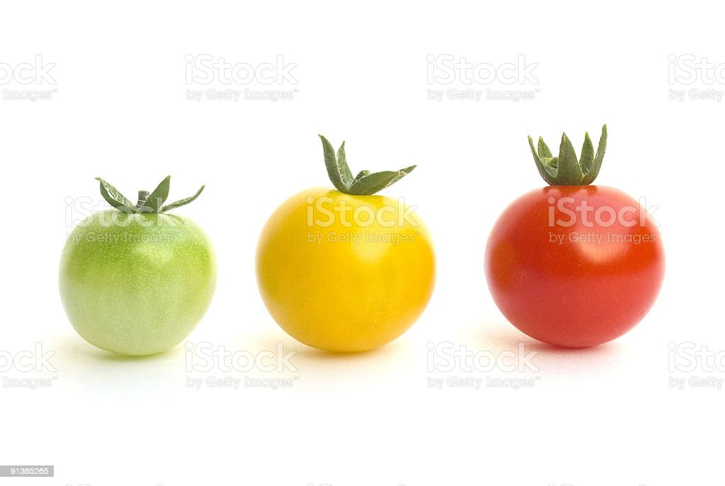 green, yellow and red tomatoes royalty-free stock photo