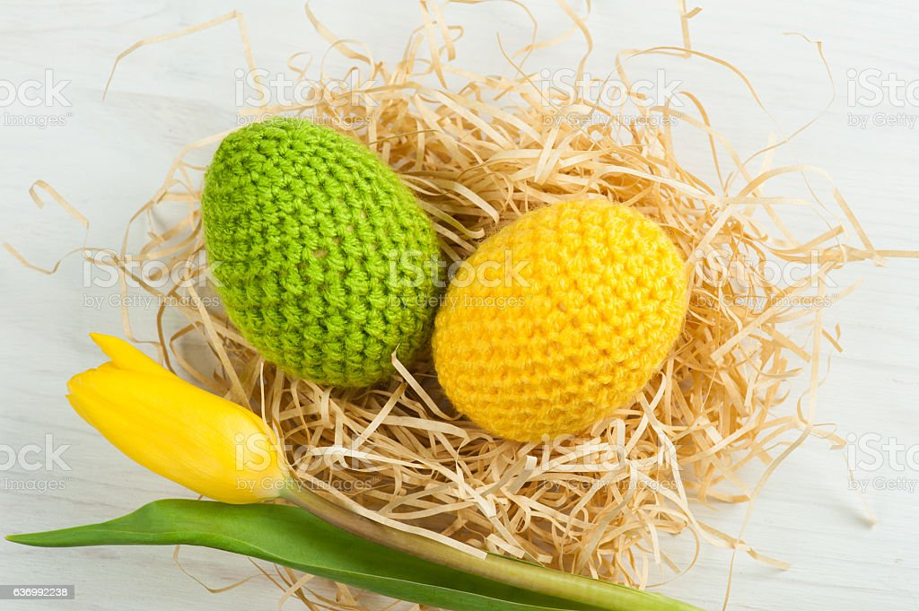 Green yellow crocheted easter eggs stock photo