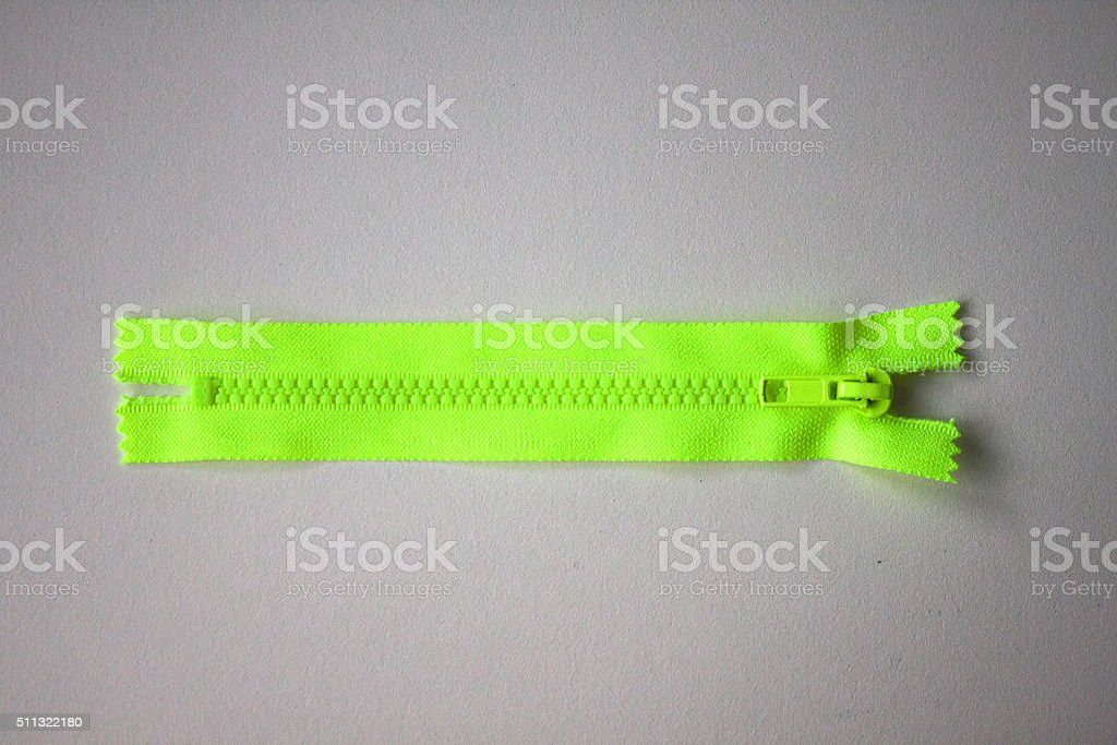 Green zipper on gray background stock photo