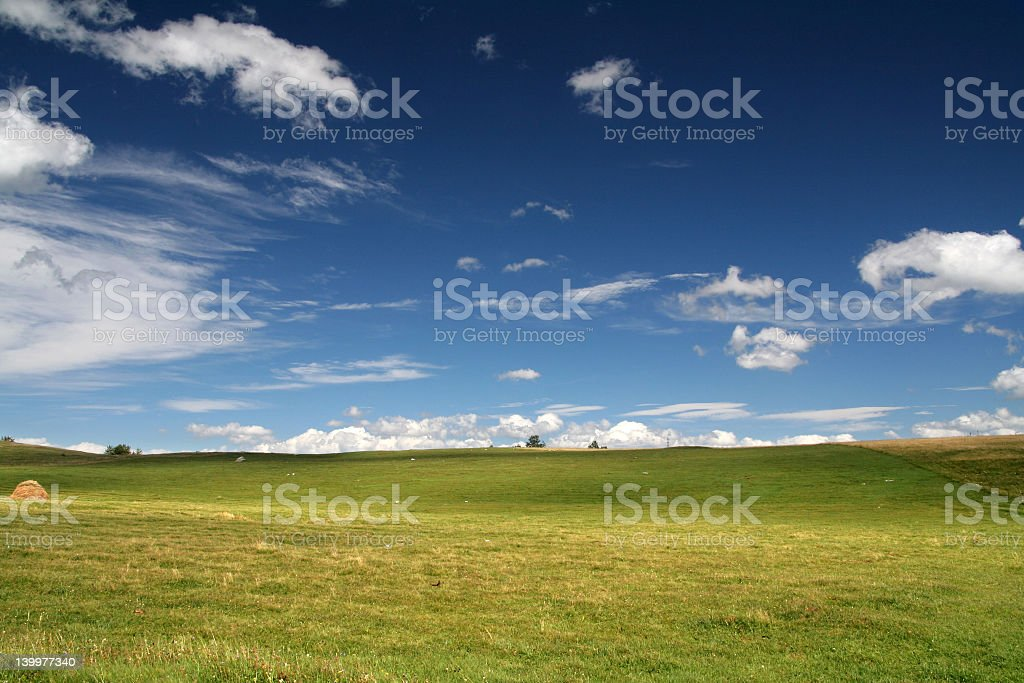 Greenfield landscape with cloudy sky royalty-free stock photo