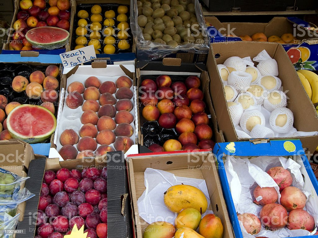 Greengrocer's shop with boxes of fruit royalty-free stock photo