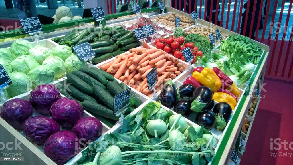 Greengrocery with shelf with fresh vegetables and fruits stock photo