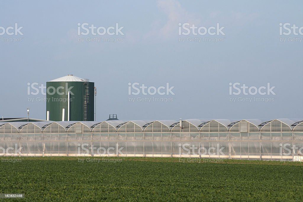 Greenhouse and Hot Water Reservoir royalty-free stock photo