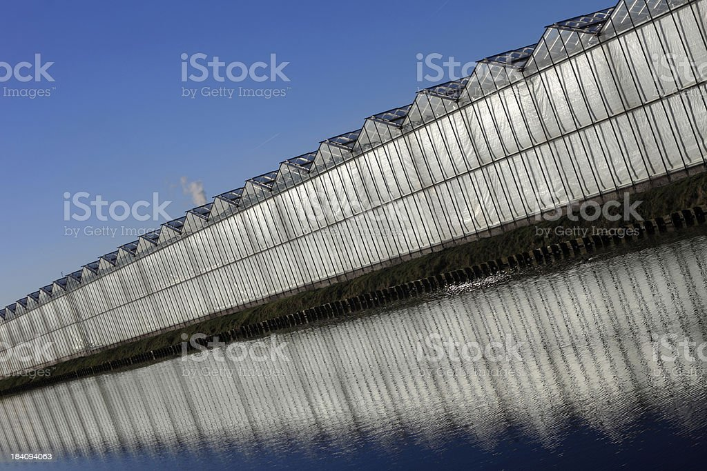 greenhouse and its reflection in the water royalty-free stock photo