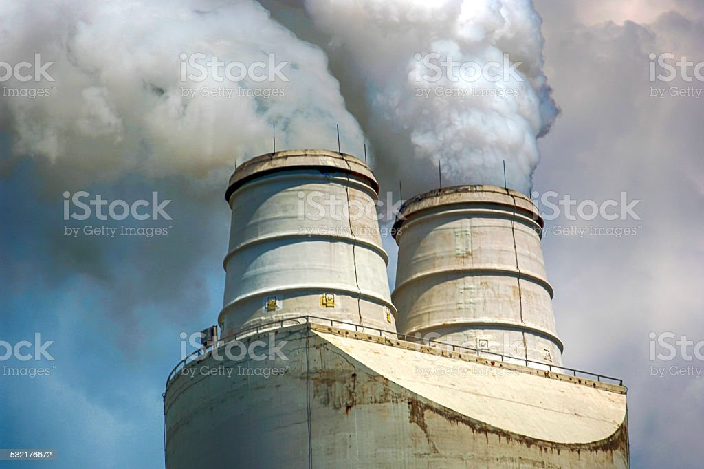 Greenhouse gases belching from an Industrial chimney in Michigan stock photo
