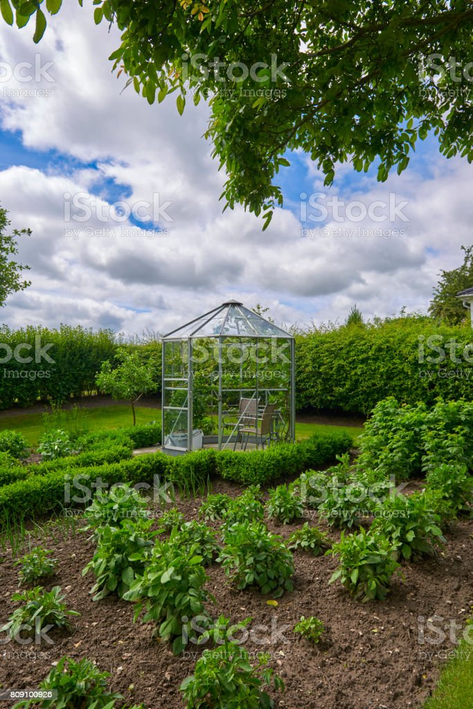 Greenhouse in the garden stock photo