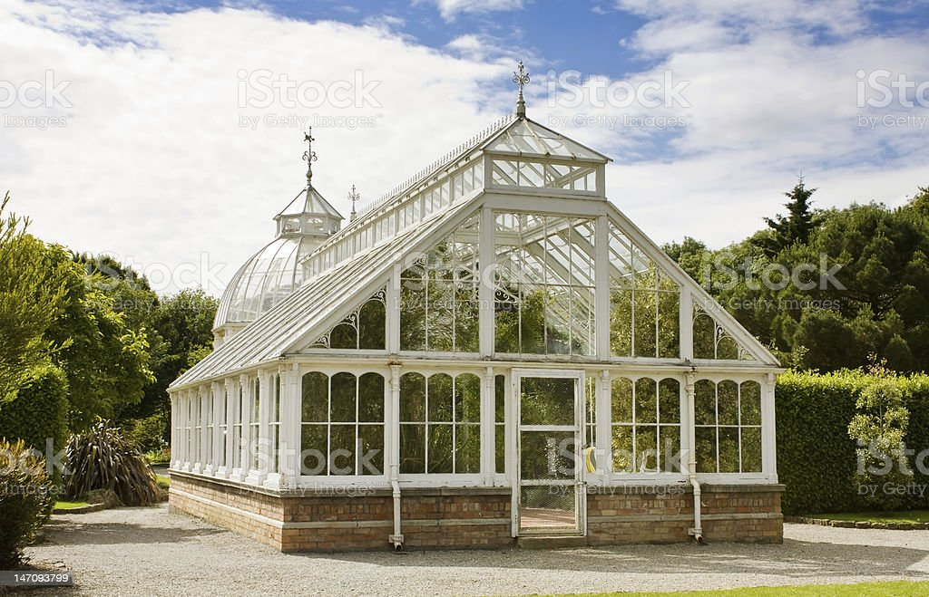 Greenhouse in the garden - rear view royalty-free stock photo