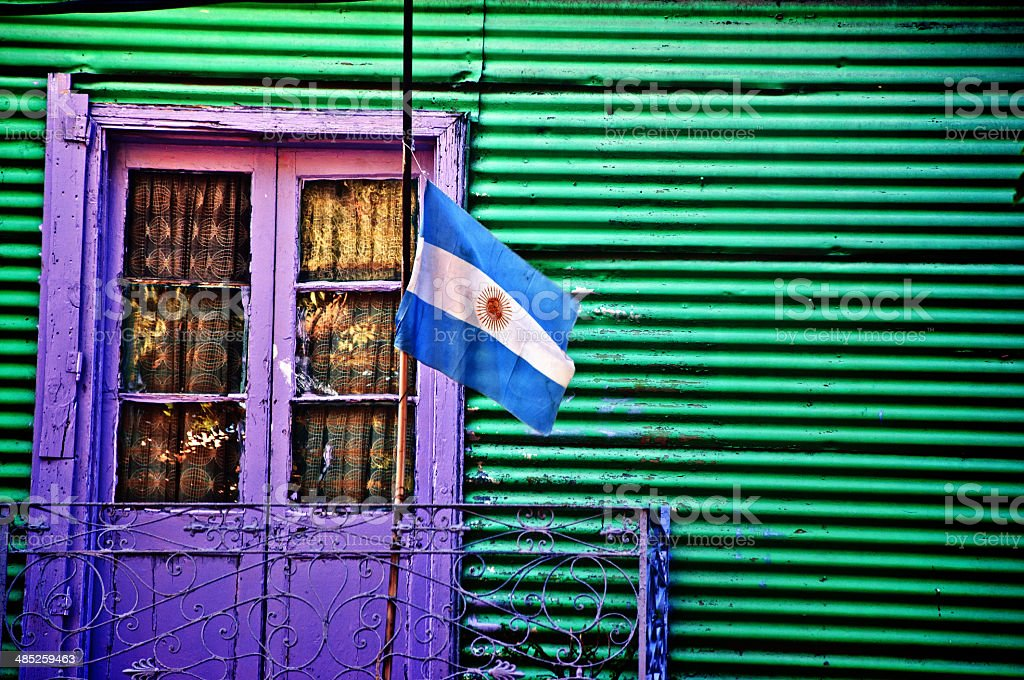 Greenish Wall with a Purple Door stock photo