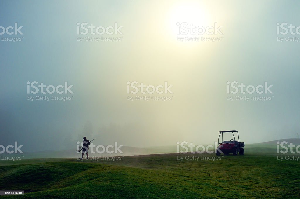 Greenkeeper on the golf course stock photo